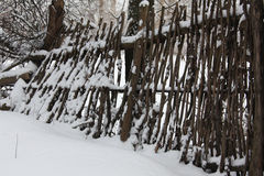 Winter. Lath fence in old garden covered with deep snow Stock Image