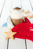Winter latte coffee in white tall glass with christmas cookies stock photo