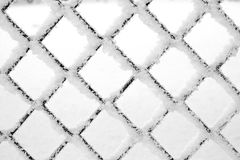 Metal grid in frost . barrier or fence or obstructive concept. Winter lattice in the frost texture metal rhombus Royalty Free Stock Photo