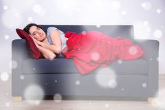Winter leisure concept - woman sleeping on sofa at home Stock Image