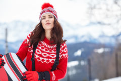 Winter, leisure, sport and people concept - happy young woman Royalty Free Stock Photography