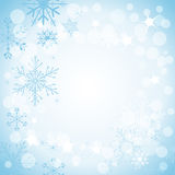 Winter light blue background. With snowflakes Royalty Free Stock Photography