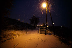 Winter lights. In the snow streets Stock Photos