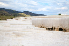 Winter-like mountain landskape with white travertine instead of Stock Images