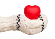 Winter, little girl's hand holding rubber heart isolated on whit Stock Images