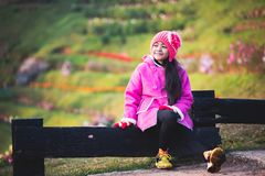 Little girl wearing clothes in winter day royalty free stock photos