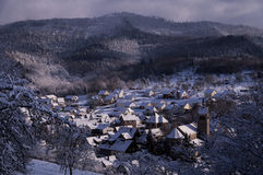 Winter in a Little Village in the Black Forest, Germany. View over a little village in the Black Forest, Germany, covered in snow during winter Stock Photos