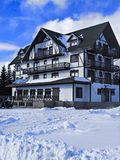 Winter lodge. Winter hotel with snow and blue sky Royalty Free Stock Image