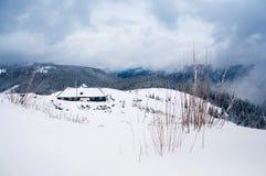 Winter lodge among mountains royalty free stock photo