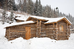 Winter log cabin Stock Images
