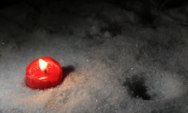 Winter, lonely  red candle Stock Photography