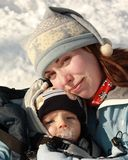 Winter love. Mother hugging her baby boy outside in winter Royalty Free Stock Photos