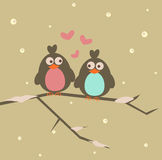 Winter love. Two loving birds sitting on a winter tree Stock Image