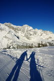 Winter love. Hand in hand in the Alps Stock Photo