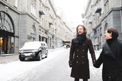 Winter love story, a beautiful stylish young couple. Royalty Free Stock Photos