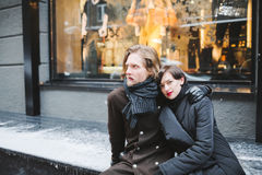 Winter love story, a beautiful stylish young couple. Royalty Free Stock Images