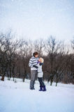 Winter lovers man and woman walk in winter forest, snow Stock Photo