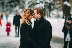 Winter LoveStory in Valentine`s day. Girl and guy happy and smiling Royalty Free Stock Image