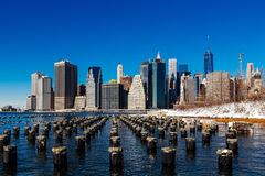 Winter Lower Manhattan Skyline with snow, New York United States. Winter at Lower Manhattan Skyline with snow view from Brooklyn Bridge Park, New York United Stock Image