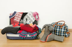 Winter luggage. Suitcase full of wither clothes. Stock Photography