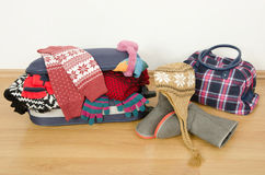 Winter luggage. Suitcase full of wither clothes. Royalty Free Stock Image