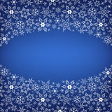 Winter luxury stylish frame with snowflakes. Beautiful winter oval frame blue with white stylized snowflakes. New Year and Christmas festive card with place for Stock Images