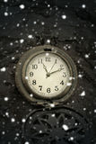 winter magic. antique poсket watch and falling snow Royalty Free Stock Image