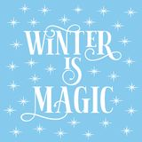 Winter is magic- text, with shining stars, on iceblue background