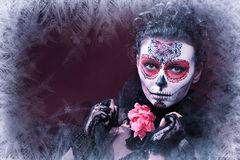 Winter make up sugar skull. Beautiful model with ice. Santa Muerte concept royalty free stock photography