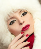 Winter makeup . Winter makeup with red lips and fingernails on a beautiful young girl royalty free stock photos