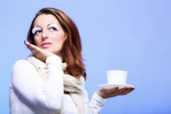 Winter makeup woman with cup of hot beverge Stock Images
