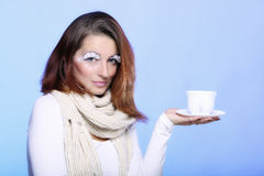 Winter makeup woman with cup of hot beverge Stock Photos