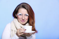 Winter makeup woman with cup of hot beverge Royalty Free Stock Photos
