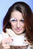 Winter makeup woman with cup of hot latte coffee Royalty Free Stock Images