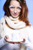 Winter makeup woman with cup of hot latte coffee Stock Photos