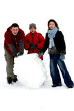 Winter - Making Snowman 2. Man, girl and boy making snowman Royalty Free Stock Images
