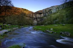 Winter at Malham Cove. Rare event at Malham Cove - Waterfall over the cliffs Royalty Free Stock Photography