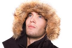 Winter man. Picture of a young sexy man with black hood Stock Photography