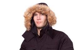 Winter man. Picture of a young sexy smiling man with black hood Stock Photos