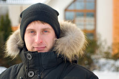 Winter - man in cap and warm jacket Stock Images