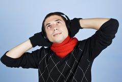 Winter man enjoying music headphones Royalty Free Stock Images
