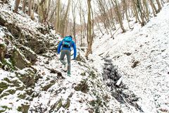 Winter Man hiking trekking in white forest. Travel recreation fitness and healthy lifestyle in beautiful snowy nature. Winter trek in white woods. Man hiking stock photos