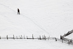 Winter with man trying to find his way Royalty Free Stock Image