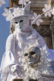 Winter mask at carnival in Venice. A white woman with a mask representing the winter, posing in San Marco Square, Venice, Italy Stock Images