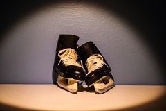 Winter memories. Small set of skates lean forgotten Royalty Free Stock Photography