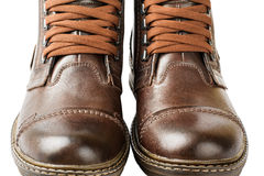 Winter Men's lace boots with fur, isolated on white background. Winter boots, men's, brown, with laces and thick soles Royalty Free Stock Images