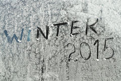 Winter text by letters on a frozen window Royalty Free Stock Image