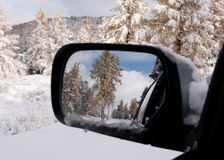 Winter in the mirror. Winter in the rear-view mirror of auto Stock Image