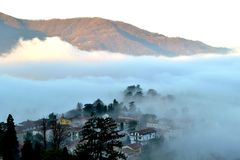Winter mist descended on Calolziocorte valley. Royalty Free Stock Photography