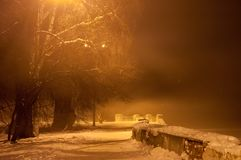 Winter misty embankment in the light of lanterns.  royalty free stock photo